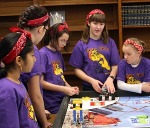 Girls around robotics table